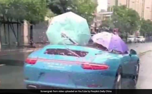 Click image for larger version  Name:china-rain-umbrella-porsche-650-youtube_650x400_71506410420.jpg Views:186 Size:23.7 KB ID:24834